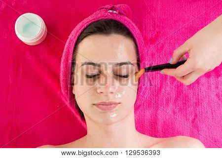 Gorgeous Woman Applying Facial Clay Mask. Beauty Treatments.