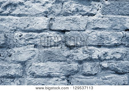 the old textured surface of a silvery brick wall for wallpaper and for a background