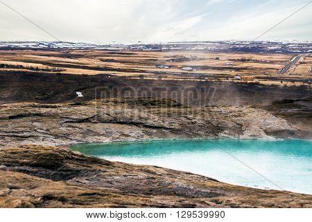 Geysir Geyser In Iceland With Steamy Water