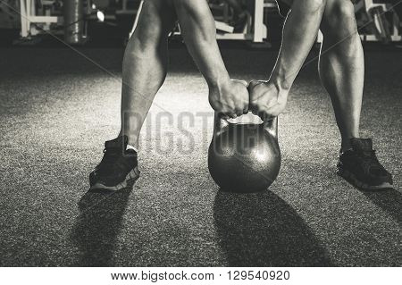 crossfit kettlebell training in gym closeup. Black and white
