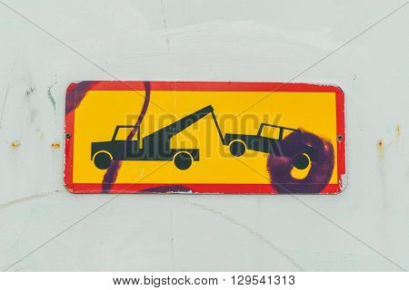 Sign Of A Truck Removing A Car