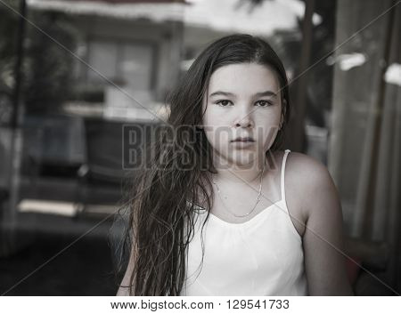 Portrait of a sad girl in a summer T-shirt. Monochrome black and white photo