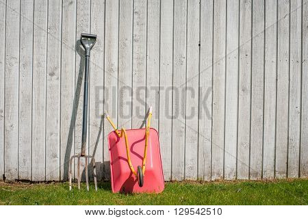 Pitchfork And A Wheelbarrow In A Garden