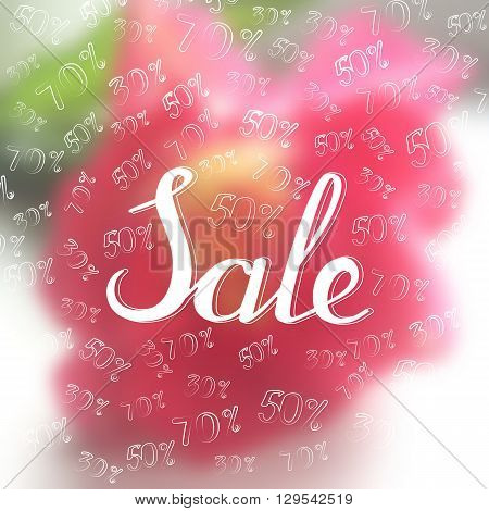 Spring sale background with lettering on the blurred background. Percent - fifty, thirty, seventy.