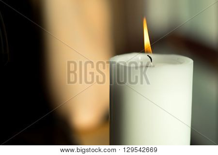 Large Candle With A Burning Flame