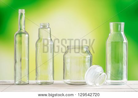Empty Glass Bottles On A Table
