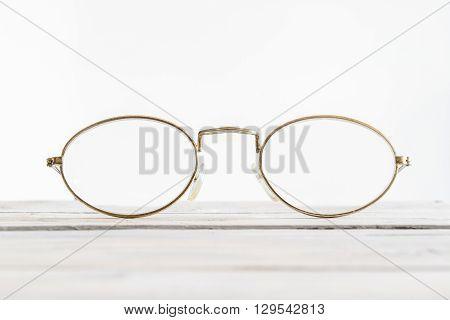 Eyeglasses On A Wooden Desk