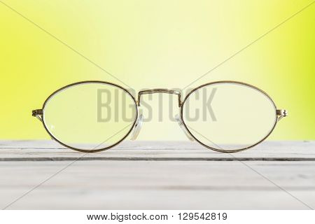 Glasses On A Table On Green Background