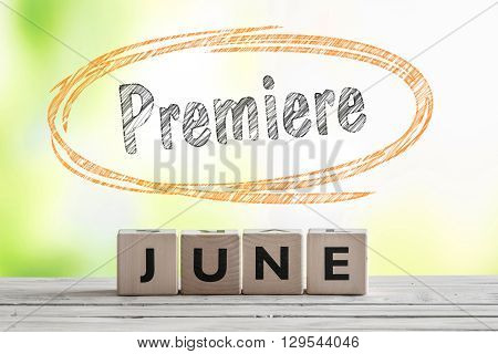 June Premiere Sign On A Wooden Stage