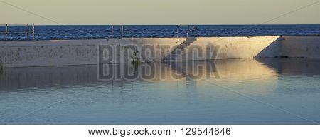 Salt water swimming pool in late evening light, Newcastle, NSW, Australia