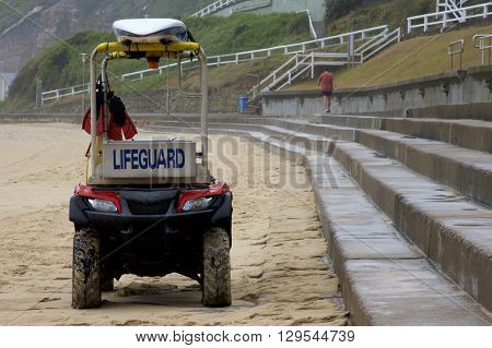 Lifeguard vehicle on the beach, Newcastle, Nsw, Australia