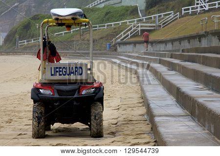 Lifeguard vehicle on the beach, Newcastle, Nsw, Australia