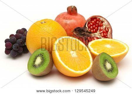 Still life from ripe varicoloured fruit on white background