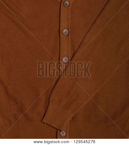 men's brown knitted cardigan with buttons. fragment
