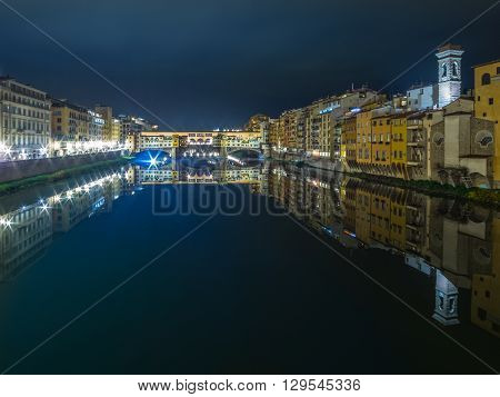 italy florence arno river and vecchio bridge at night