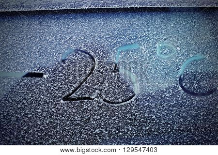 Inscription on the frosted windshield. Cold in winter