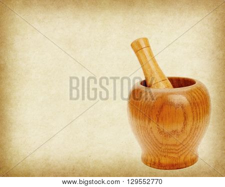 Wooden mortar and pestle on old paper