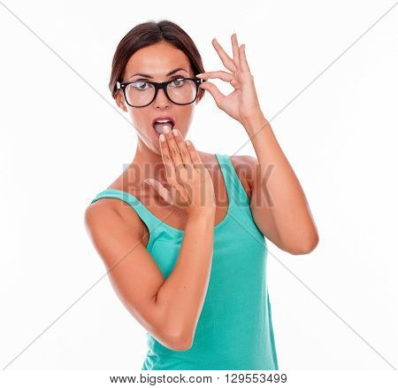 Surprised Adult Woman With A Hand To Her Mouth