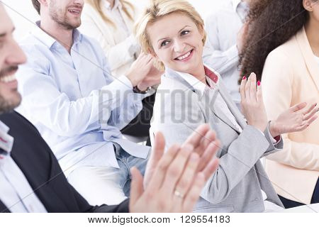 Shot of a group of coworkers clapping their hands
