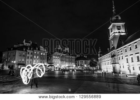 Warsaw, Poland - June 25, 2015: fire show in evening on a Warsaw square, Poland