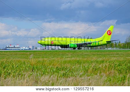 SAINT PETERSBURG RUSSIA - MAY 11 2016. S7 Siberia Airlines Boeing 737 Next Gen -registration number VP-BND- is riding on the runway after landing in Pulkovo International airport