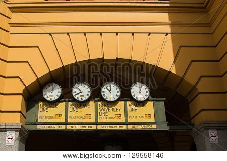 MELBOURNE, AUSTRALIA - APRIL, 2016 : Station clocks at main entrance of Flinders Street Railway Station in Melbourne, Australia on April 10, 2016. The station serves entire metropolitan rail network