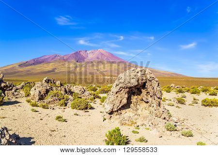 View of dormant volcano and desert in National Park Uyuni Bolivia