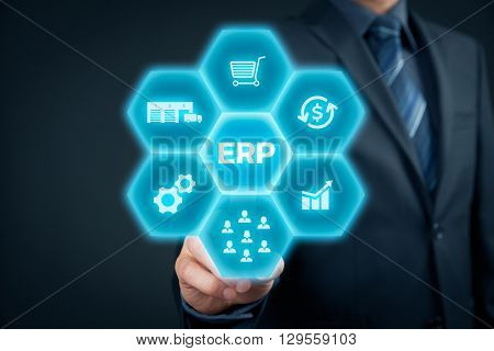 Enterprise resource planning ERP concept. Businessman click on ERP business management software button for collect store manage and interpret business data like customers HR production logistics financials and marketing.