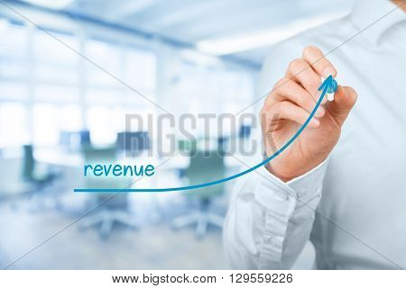 Increase revenue concept. Businessman plan revenue growth office in background.