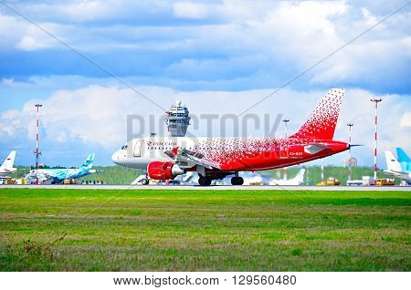 SAINT PETERSBURG RUSSIA - MAY 11 2016. Rossiya Airlines Airbus A319 airplane in new livery -registration number VQ-BCP - rides on the runway after landing in Pulkovo International airport