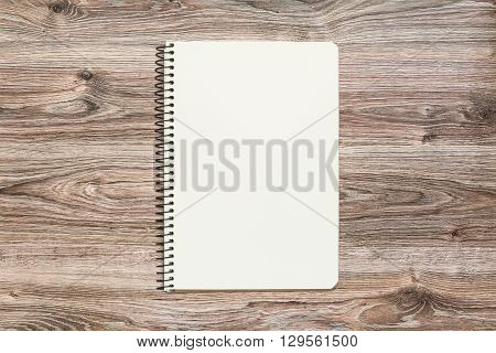 Mockup of open notepad with blank page on wooden background. Template for your design. Top view.