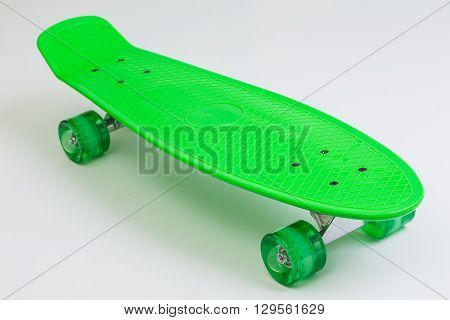 New green skateboard on a white background