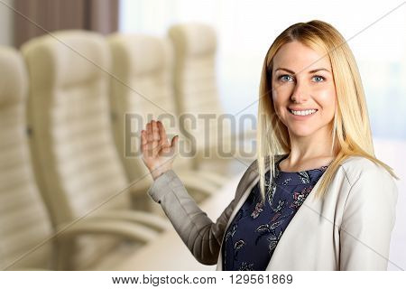 Smiling business woman presenting. Invitation to the meeting place