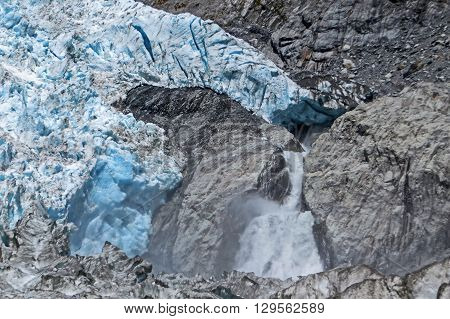 Glacier ice avalanche on a mountain in New Zealand