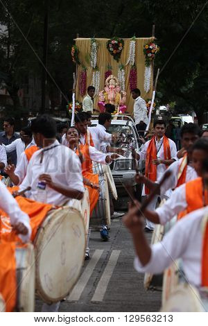 Pune India - September 17 2015: Ganesh festival procession being traditionally celebrated Dhol Tasha percussion and dancing.
