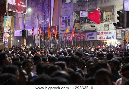 Pune India - September 28 2015: Crowds at one of the squares during Ganapati festival in India.