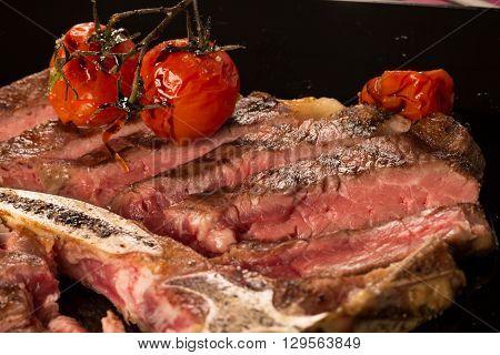 Sliced T Bone Steak On A Plate