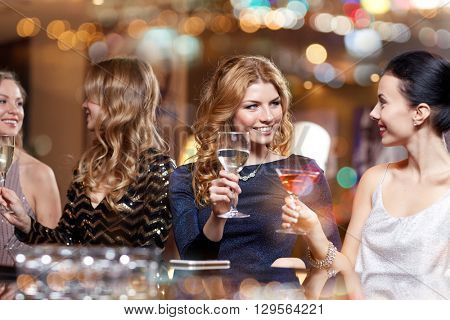 celebration, friends, bachelorette party and holidays concept - happy women drinking champagne and c