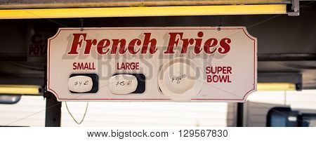 French fries sign with assorted sizes at a state fair