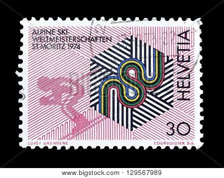 SWITZERLAND - CIRCA 1973 : Cancelled postage stamp printed by Switzerland, that shows Badge of the championships and downhill skier.