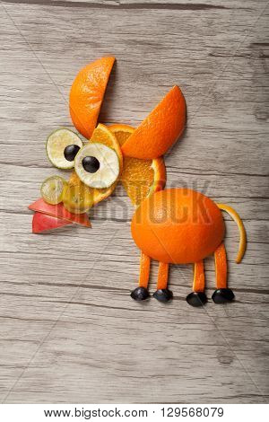 Donkey made of grape and oranges on desk