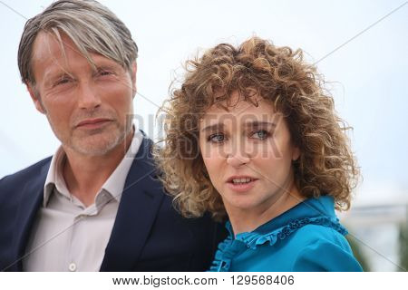 Mads Mikkelsen and Valeria Golino attends the jury photocall during the 69th annual Cannes Film Festival at Palais des Festivals on May 11, 2016 in Cannes, France.