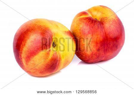 Two ripe nectarines on white background. Closeup.