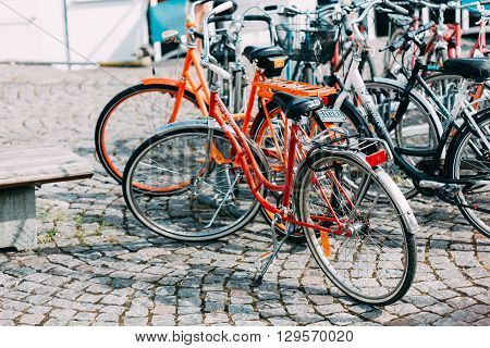 Helsinki, Finland - July 27, 2014: Parked Bicycles On Sidewalk. Bike Bicycle Parking In City