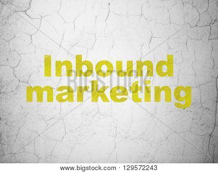 Marketing concept: Yellow Inbound Marketing on textured concrete wall background