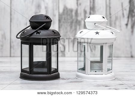 Black And White Candle Holders On White Wooden Background