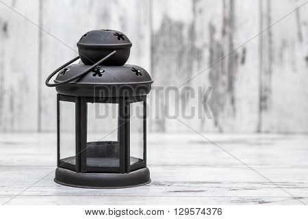 Black Candle Holders On White Wooden Background