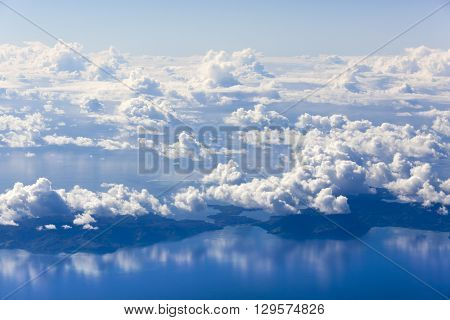 The view of Fiji islands through the window of an airplane.