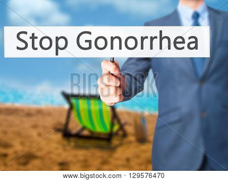 Stop Gonorrhea - Businessman Hand Holding Sign