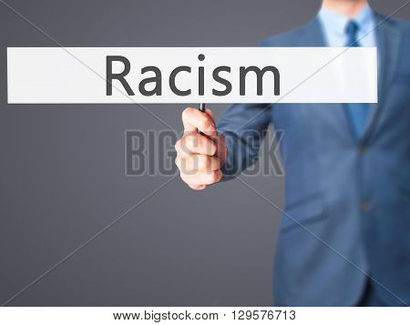 Racism - Businessman Hand Holding Sign